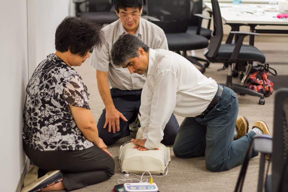 The Staff performing CPR with a Defibrillator